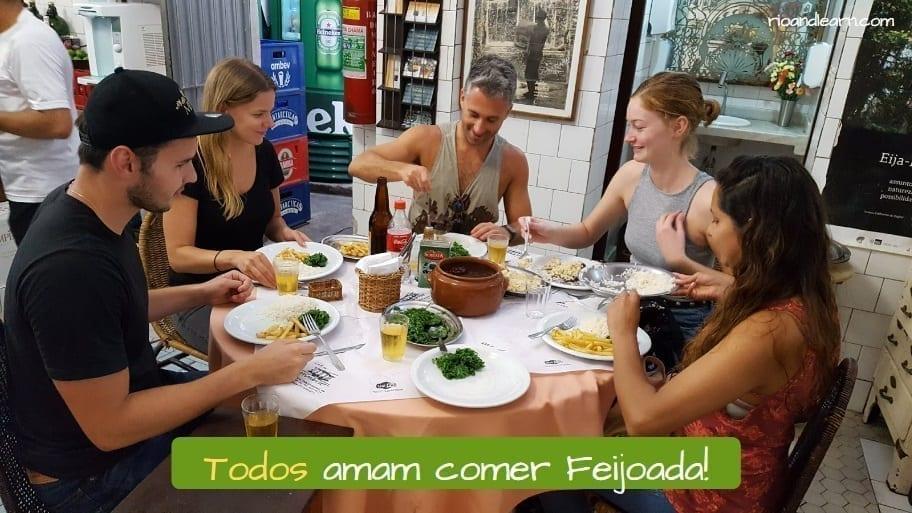 Exemplo com pronomes indefinidos em Português: Todos amam comer feijoada.