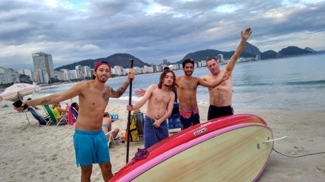 Surfing and Enjoying in Portuguese. Surfing at Copacabana Beach.
