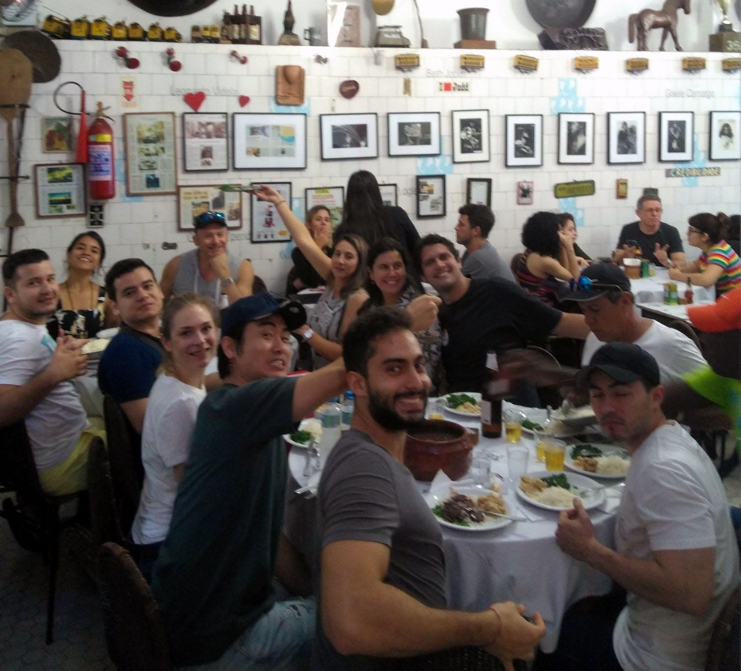 Eating feijoada in Santa Teresa with friends is the best thing in world. Students at bar do mineiro eating feijoada