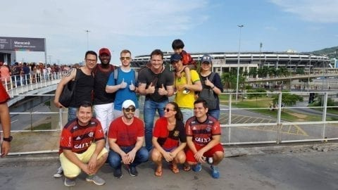 Students pose to photo in front of Maracanã