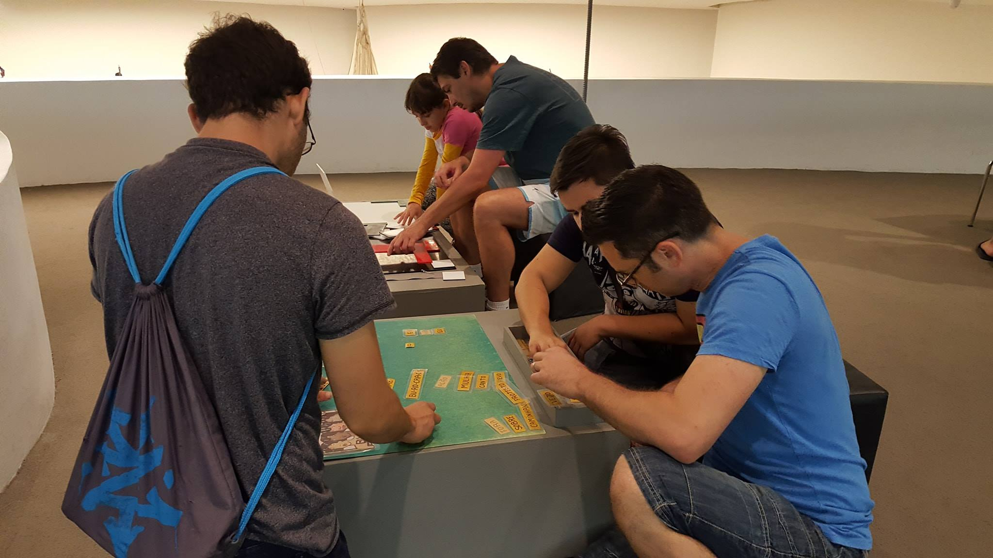 Practicing our Portuguese with a word game. students inside the oscar niemeyer museum.
