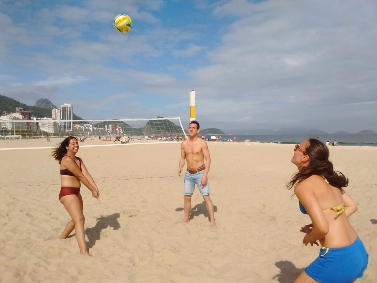 Getting a golden tan playing beachvolley in the sands of Copacabana