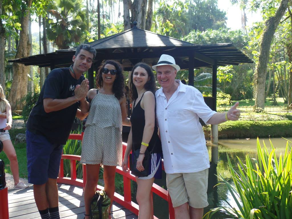 RioLIVE! Four visitors at the Japanese garden. Botanical Garden Rio de Janeiro. Four people on a bridge. Red bridge