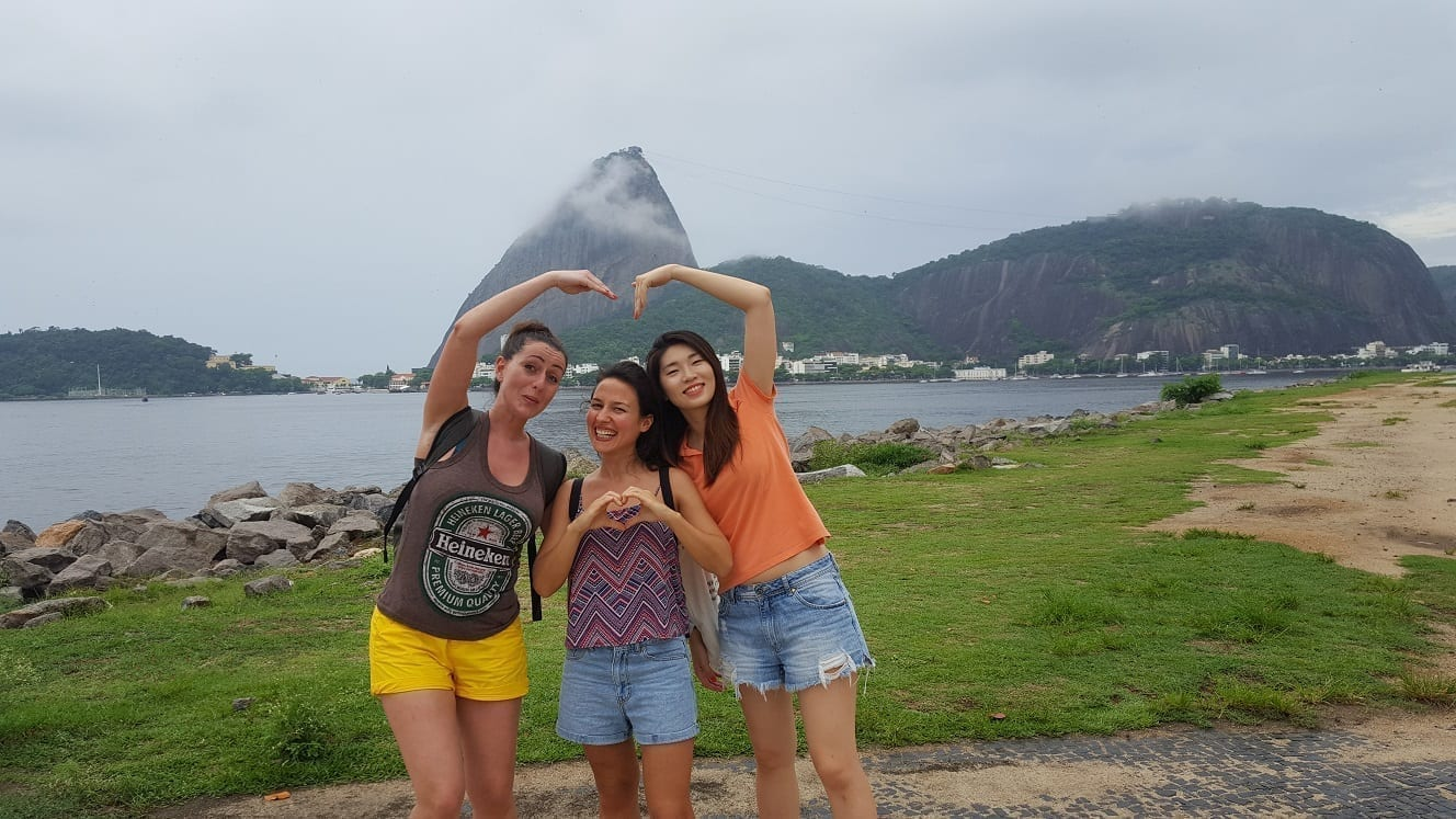 Beautiful cloudy Rio. Three beautiful girls at Botafogo, Sugarloaf in the back.