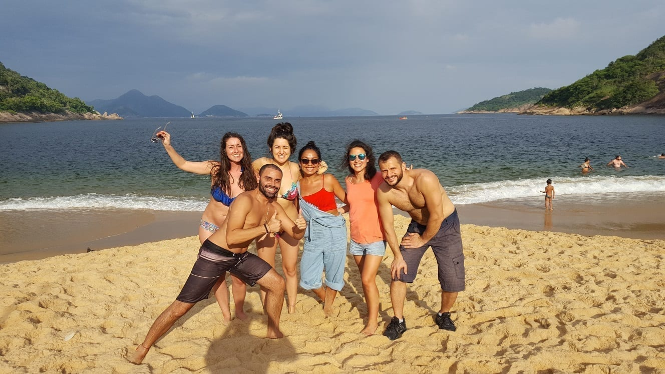 Students from different countries at Praia Vermelha in Rio de Janeiro enjoying a sunny day.