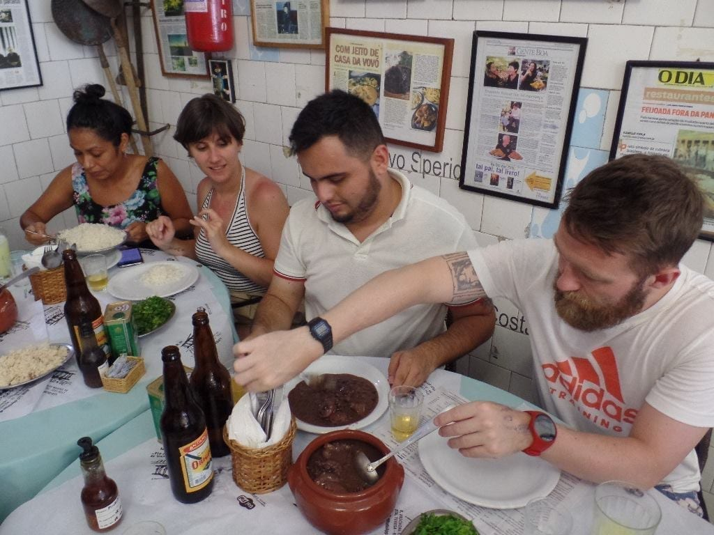 Holy Feijoada. Friends serving feijoada at bar do Mineiro, Santa Teresa.