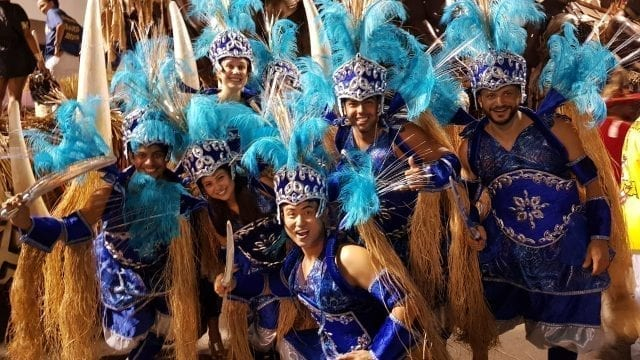 Greatest Parade in the World.Group of foreign people getting ready to be part of the Rio Carnival Parade 2019 for Unidos da Tijuca Samba School, wearing blue costumes that represent the African Orisá Ogum.