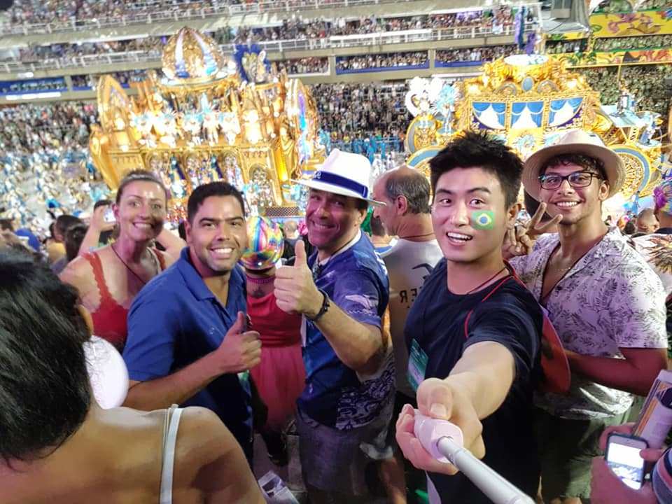 A group of foreign students pose for a selfie at the Rio Carnival Parade, at Sambadrome.