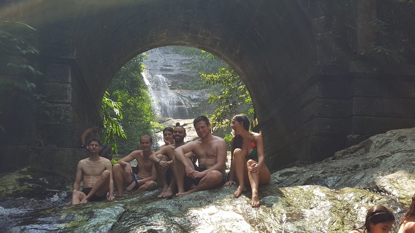 Relaxing at Cascatinha Taunay. A waterfall inside the Tijuca Forest in Rio de Janeiro.