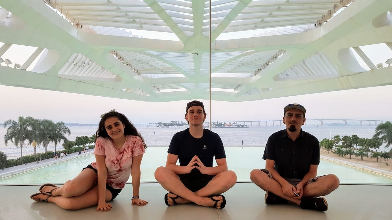 Sunset at Porto Maravilha. Three students at Museum of Tomorrow in Rio de Janeiro.