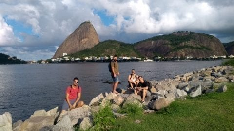 Students on the rocks at Aterro do Flamengo.