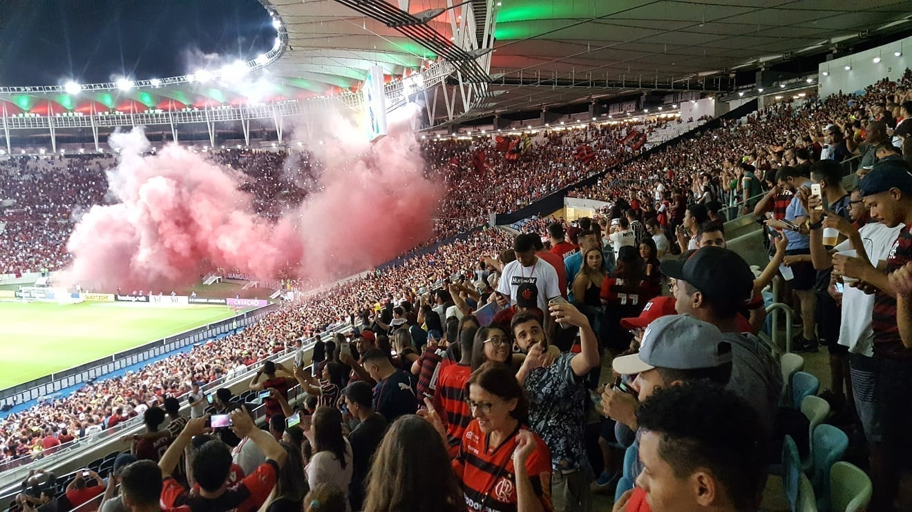 Football match between Fluminense and Flamengo at Maracanã. Smoke is when the game starts!