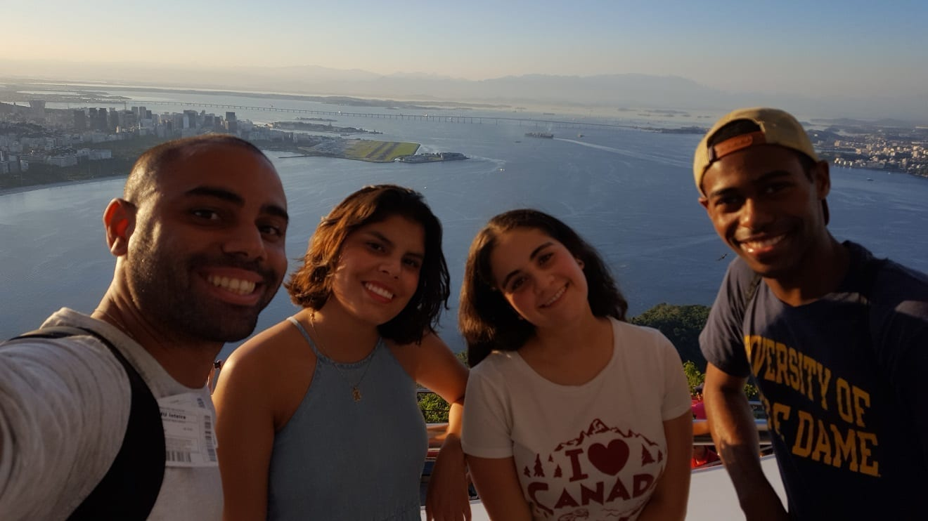 Teacher and students talking a selfie at the Sugarloaf in Rio de Janeiro.