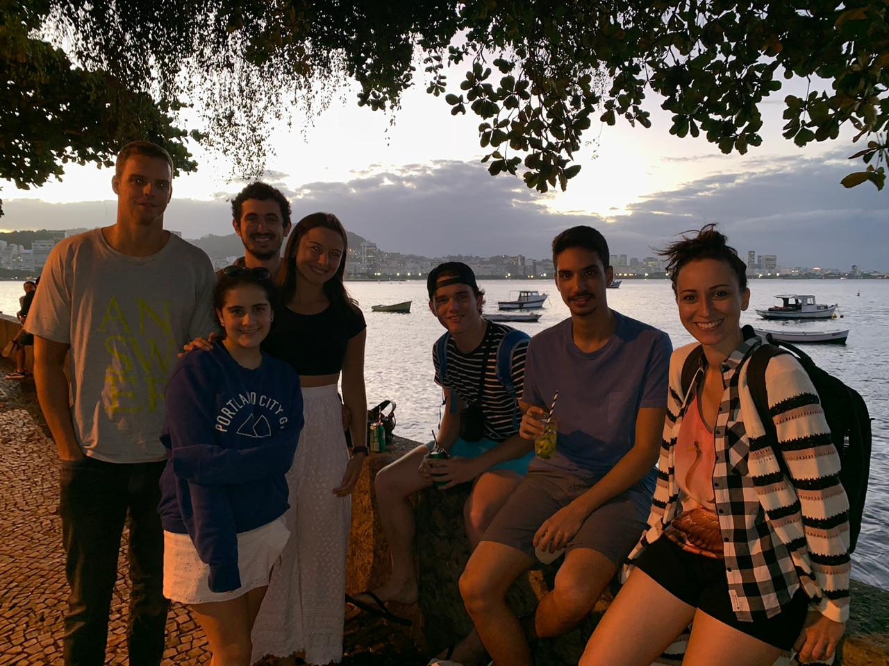 Beautiful young foreign students having some good time drinking and learning Portuguese in Urca, Rio de Janeiro
