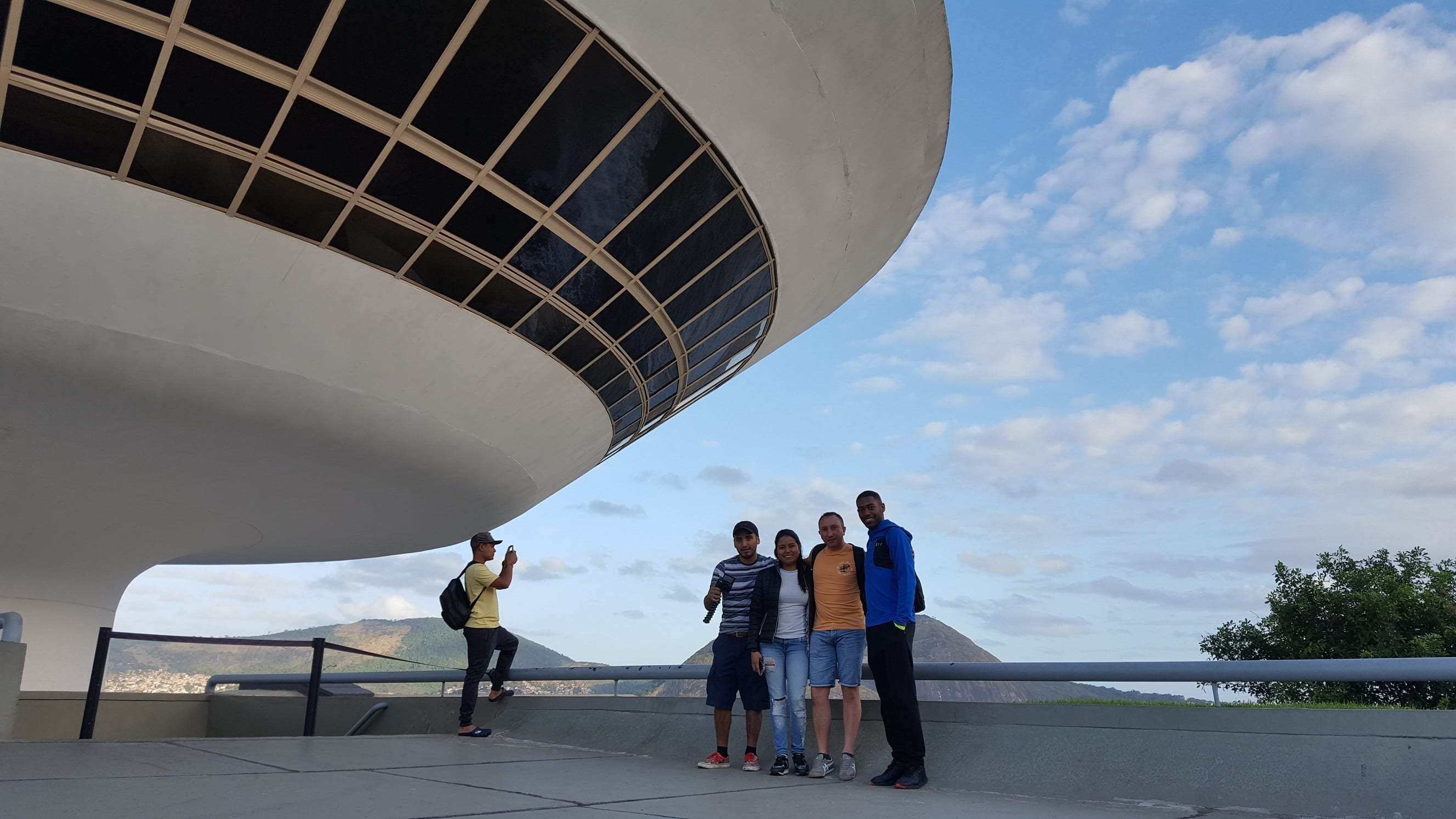 To the right of Museum of Contemporary art of Oscar Niemeyer in Niterói.