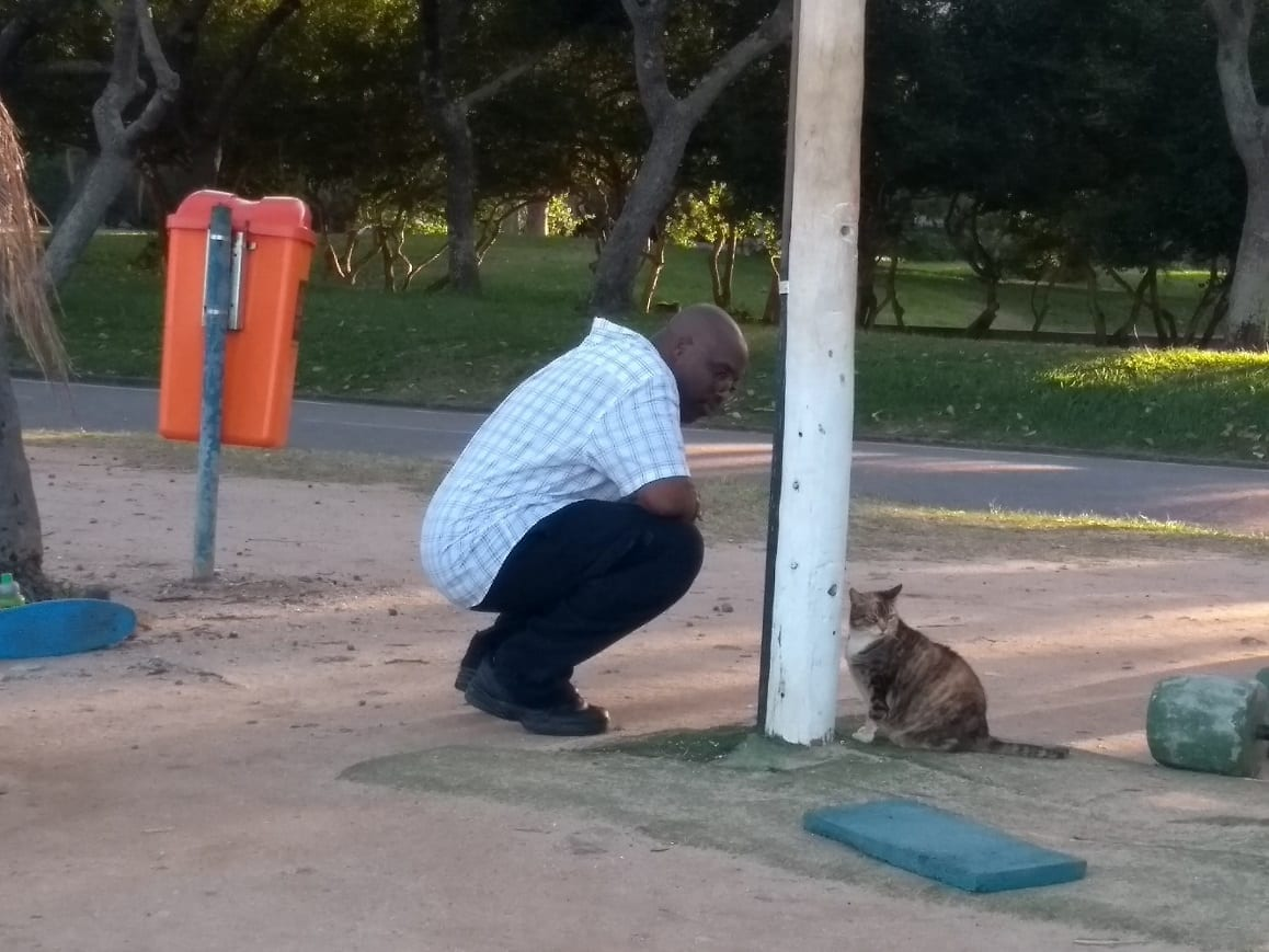 Our student Yaphet playing with a cat.