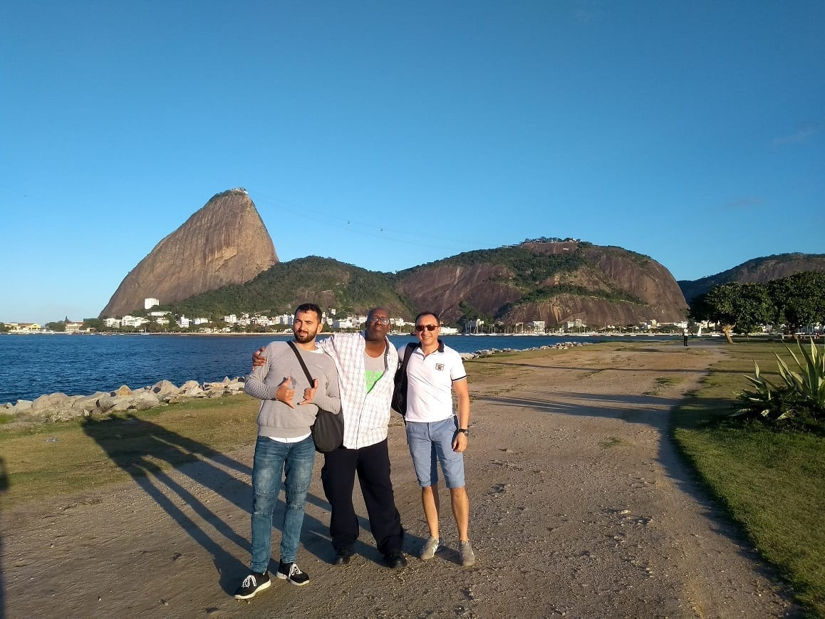 Students at botafogo beach in front of tue sugar loaf.