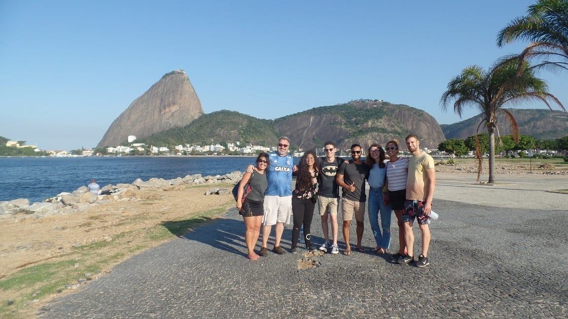 Students posing in front of the Sugar Loaf at Botafogo beach.
