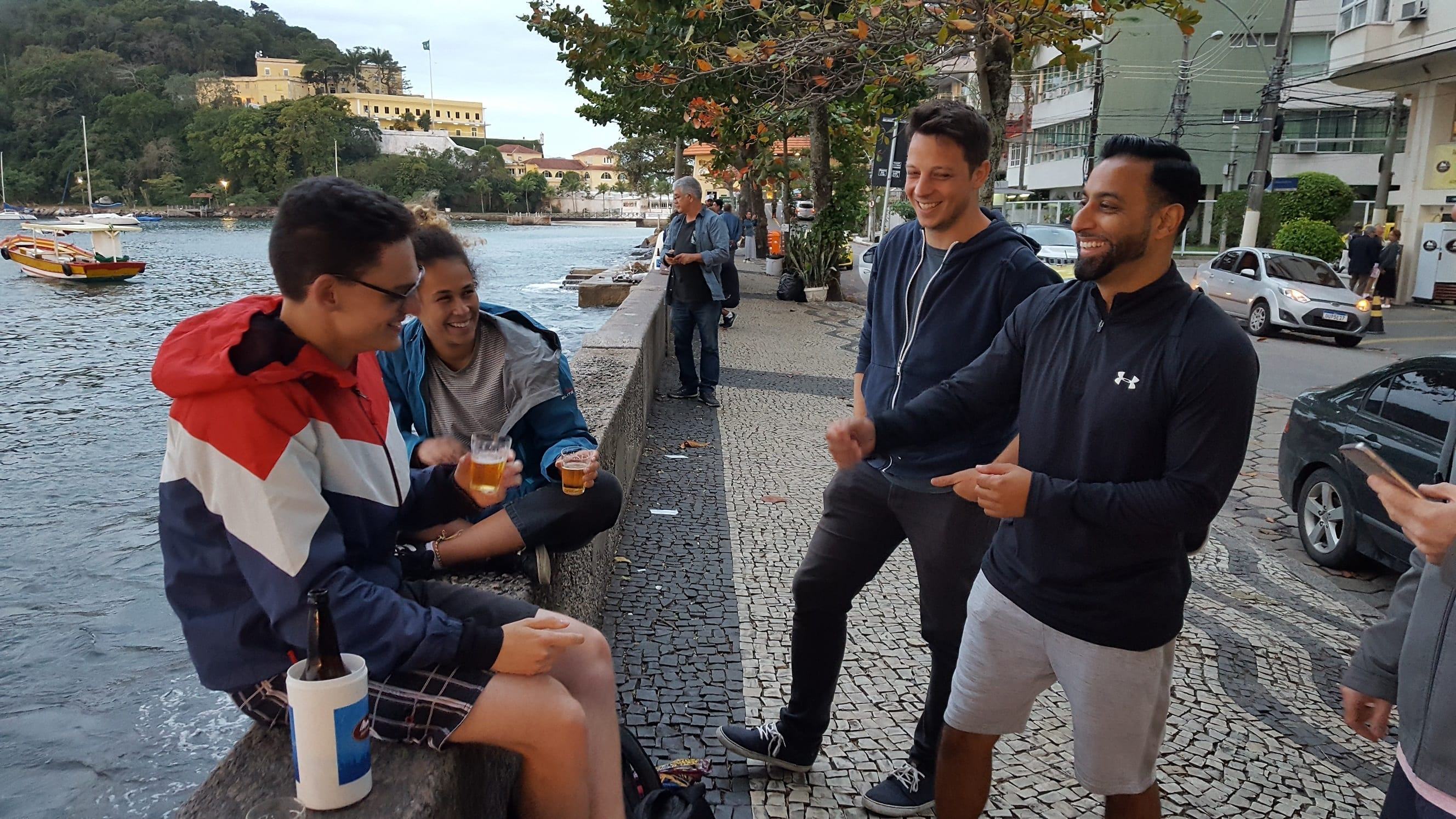 Students of Portuguese talking and telling jokes at the Urca RioLIVE! with Rio & Learn Portuguese School.