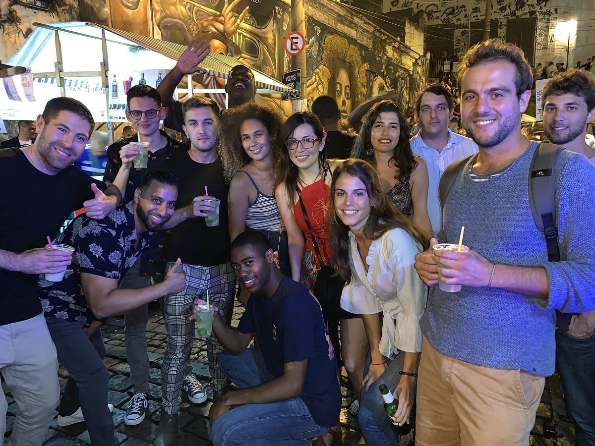Students drinking Caipi-anything-you-fancy at Pedra do Sal. The must crazy night with caipirinha and samba.