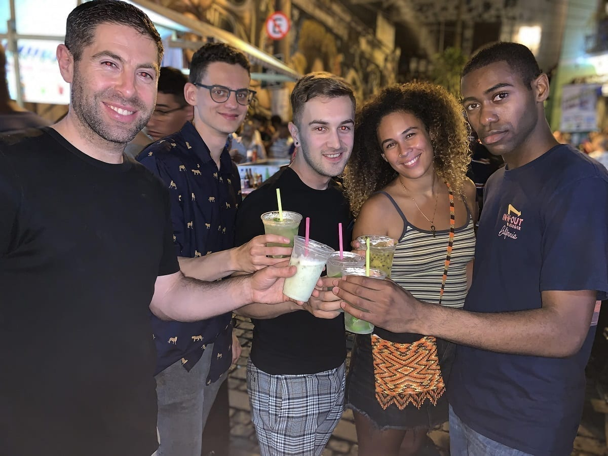 guys toasting caipirinha at Pedra do Sal