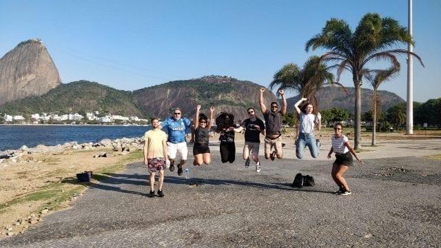 Students jumping at Botafogo beach.