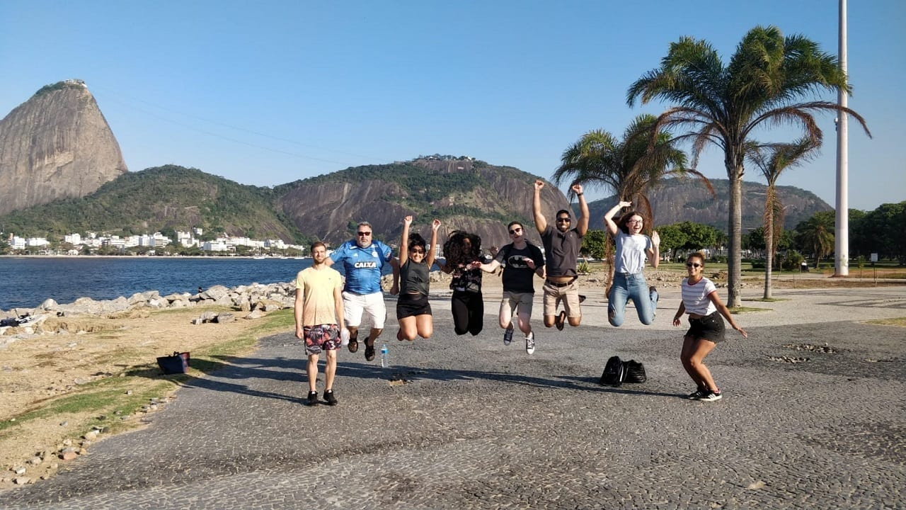 Students jumping at Botafogo beach.