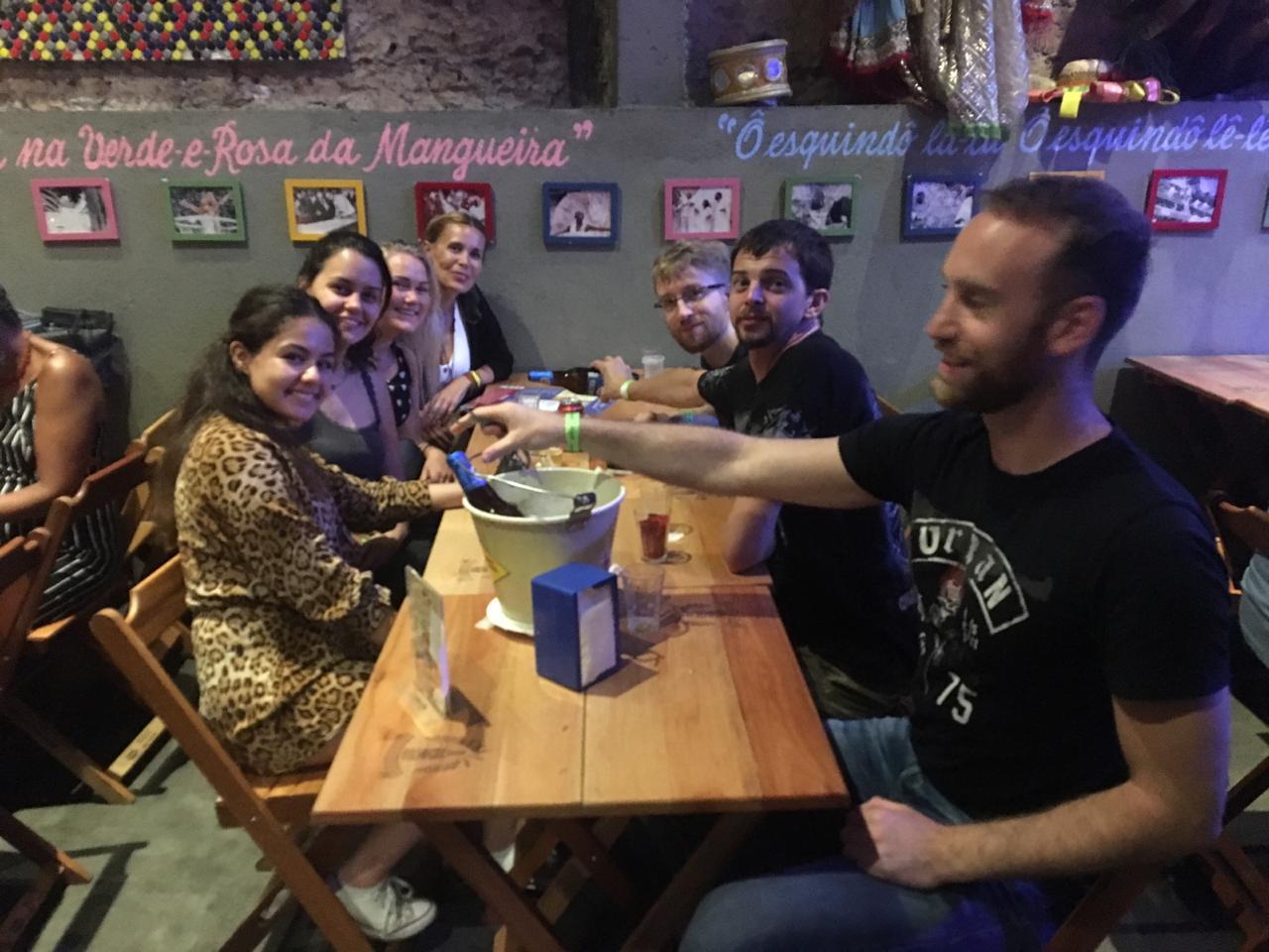 students drinking beer at the bar.