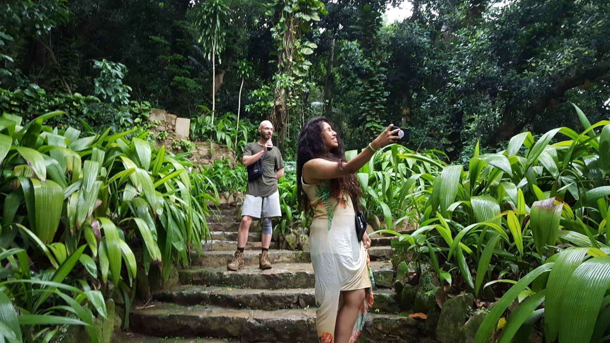 Foreign students of Portuguese taking pictures at the Botanical Garden in Rio de Janeiro.