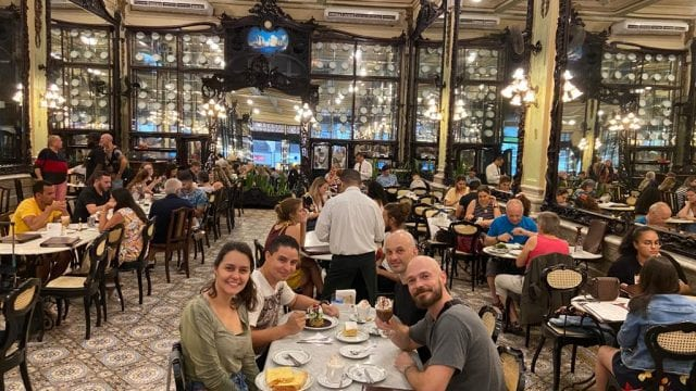 Our Afternoon Tea. Students sitting at table drinking tea at Confeitaria Colombo