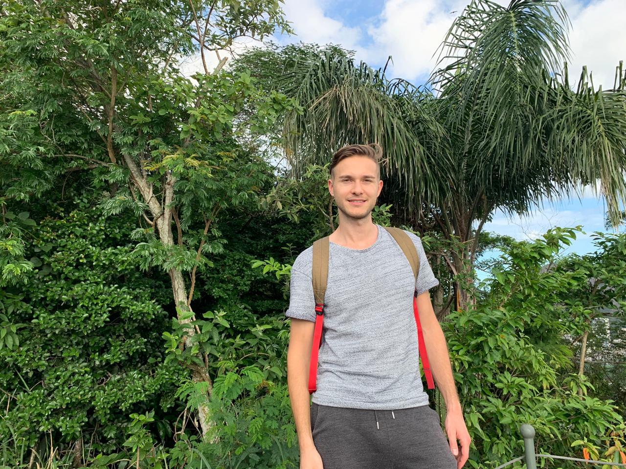 Student smiles at Catacumba Mountain
