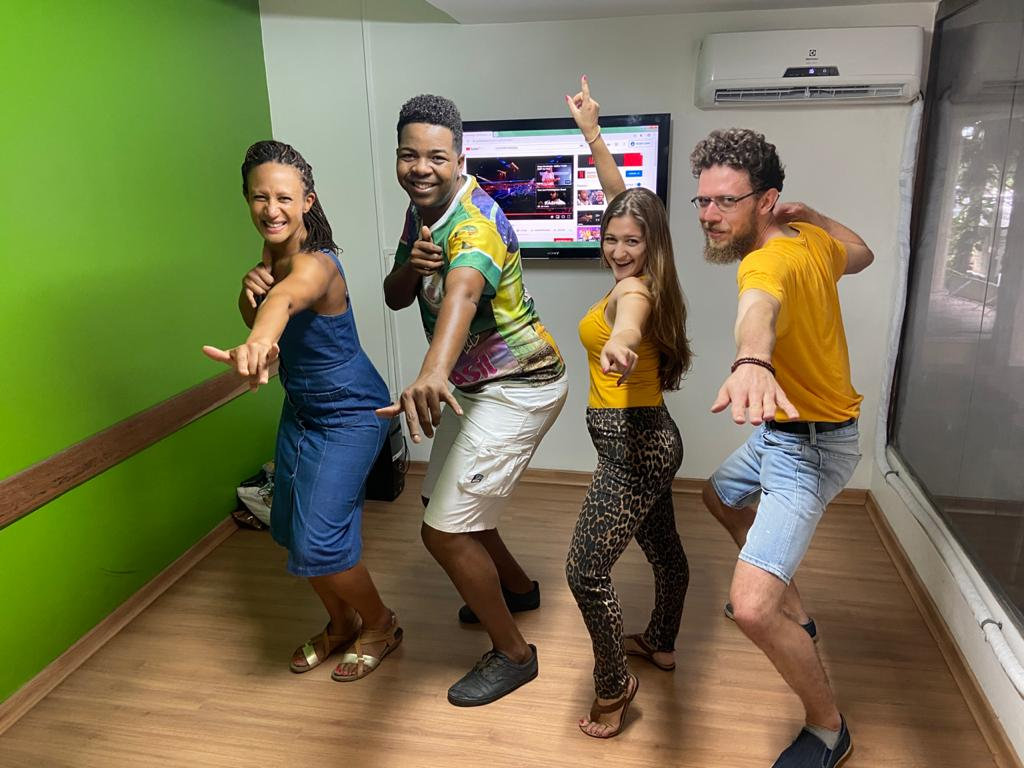 Dancing Samba in Rio. Students doing pose in the classroom with the teacher.