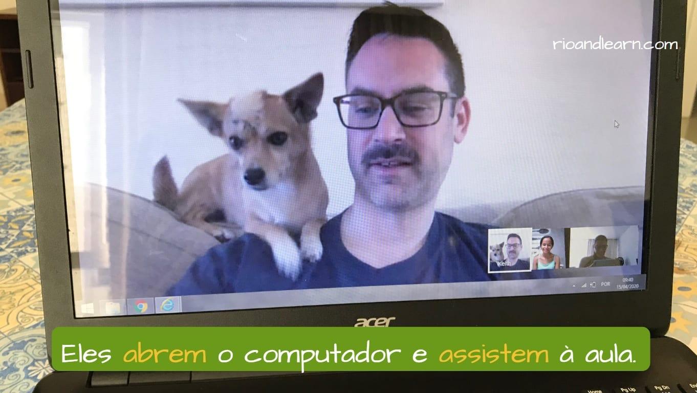 Example with Ir Verbs Present Tense: Eles abrem o computador e assistem à aula.