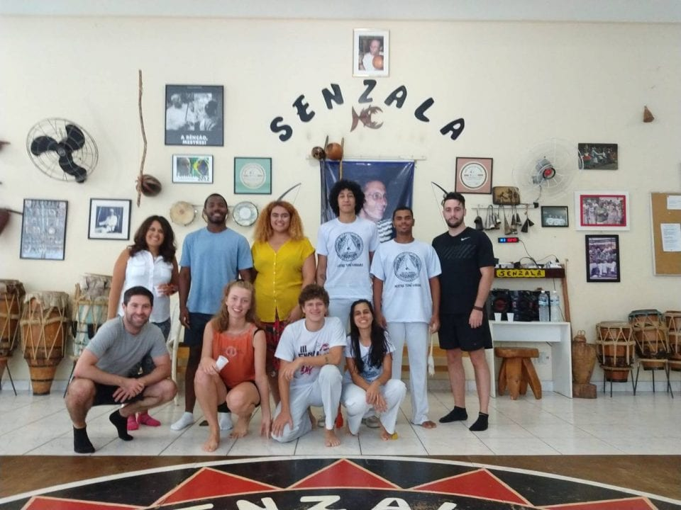 Best Way to Learn Portuguese. Learn in Brazil with people from all over the world. Immerse yourself. Picture of students from Rio & Learn at their capoeira class with Grupo Senzala.