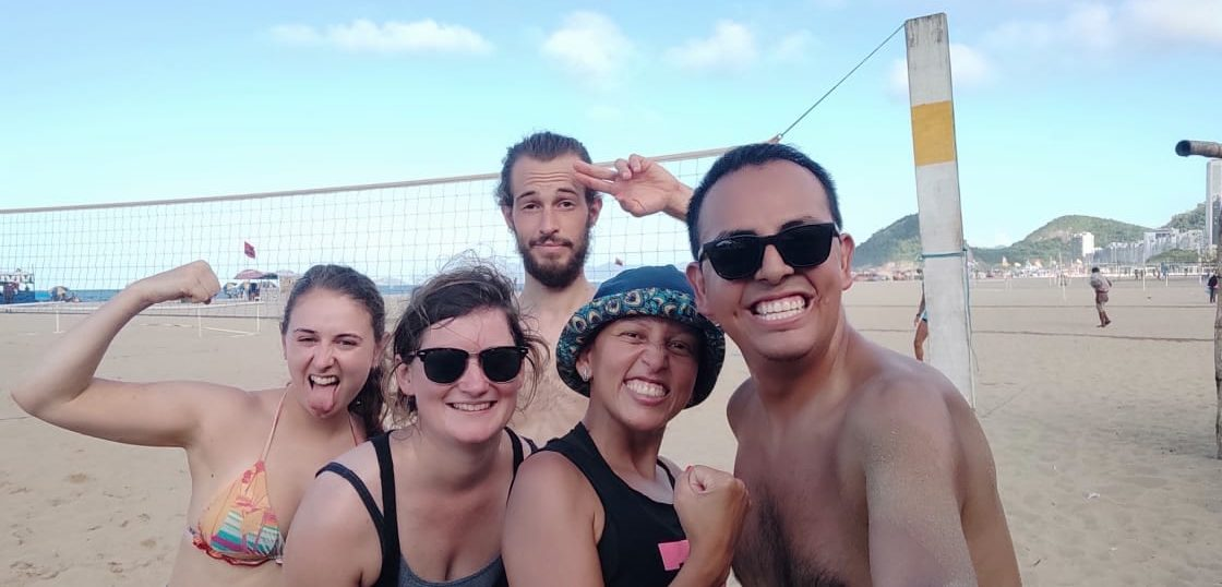 Students from Rio & Learn spend an afternoon playing beach volleyball during a RioLIVE! activity.