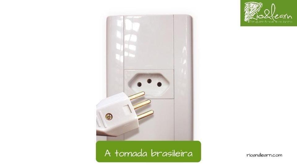Plug in Brasil: Wall socket in Portuguese - A tomada brasileira.