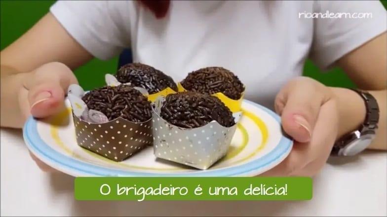 Brazilian Brigadeiro. Brigadeiro is delicious: O Brigadeiro é uma delícia.