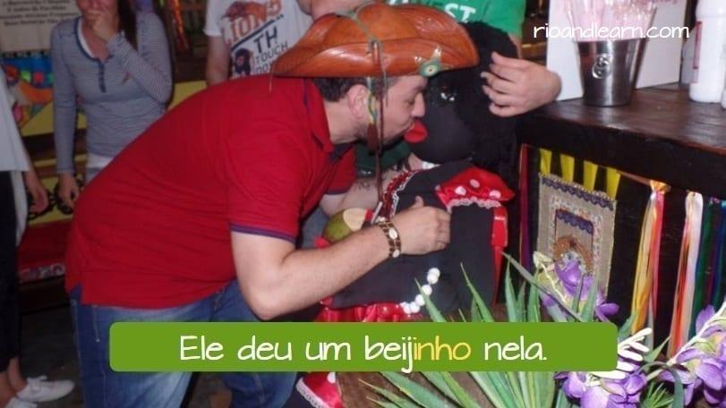 Portuguese Diminutive Exercises. Ele deu um beijinho nela.