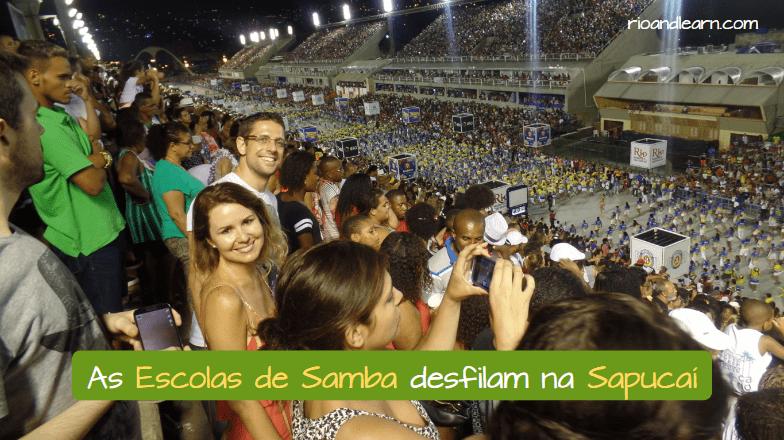 Frase para conocer que es una Escuela de Samba: As Escola de Samba desfilam na Sapucaí.