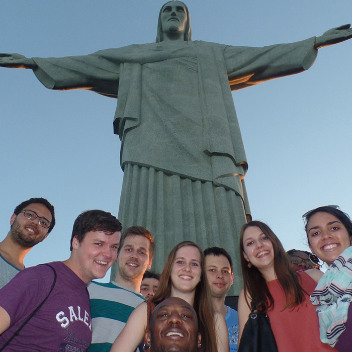 Foreign Portuguese language students visiting Christ the Redeemer.