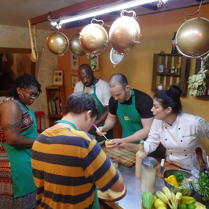 Portuguese language students having a cooking class in Rio de Janeiro.