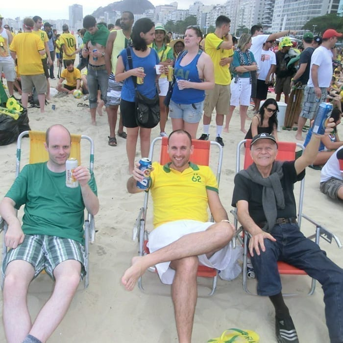 Foreigners students having a beer at Copacabana beach.