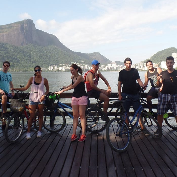 Foreigners students having a Portuguese class at Lagoa Rodrigo de Freitas. Portuguese immersion in Brazil.