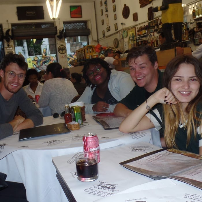 Portuguese Immersion with foreigners students practicing in a Brazilian restaurant.