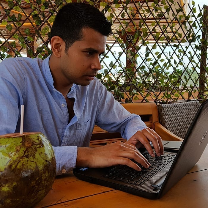 Online Portuguese Classes by Rio & Learn. Student studying Portuguese from his notebook.