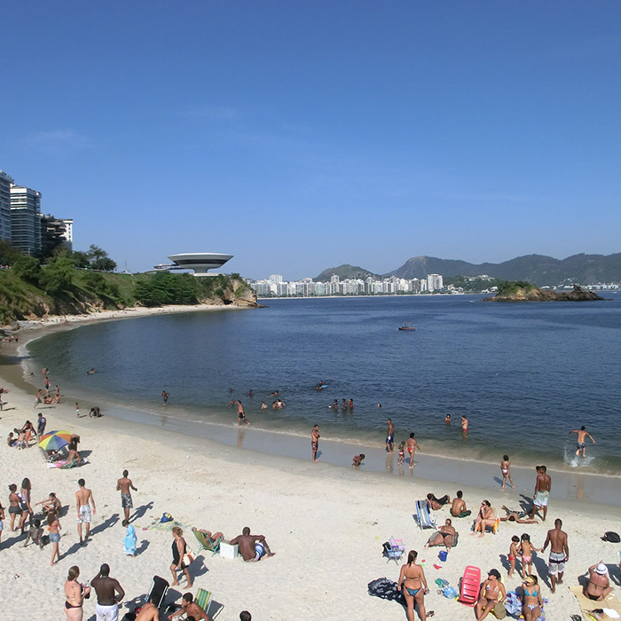 Boa Viagem beach in Niterói. Brazilians enjoying the beach in a sunny day.