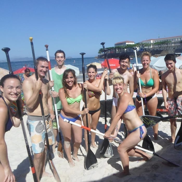 Students in a Stand up paddle surf activity at Copacabana.