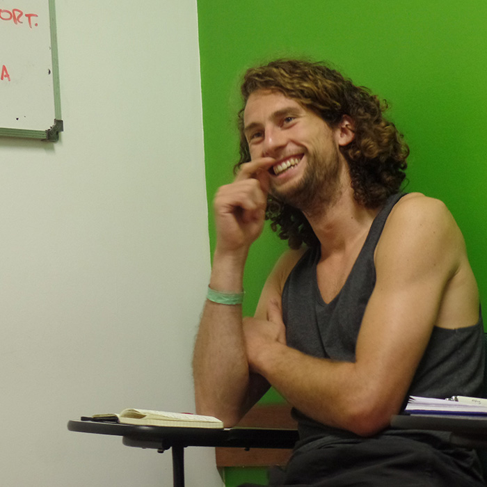 Student of Portuguese language from the Netherlands laughing due to his fun class.